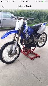 was very close to stock aside from the moose gripper seat still had the original piston in it the front tire had s so big you could see the