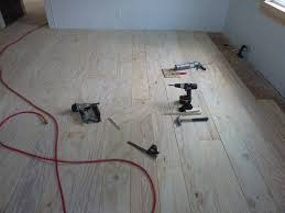 just about finished with the plywood plank floors down stairs