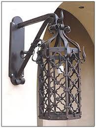 hand forged exterior lighting. iron lanterns for entry and garage lights hand forged exterior lighting