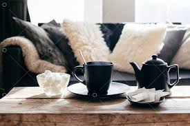 Still life details of <b>nordic living room</b>. Cup of hot tea with steam on a ...