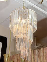 a vintage chandelier composed of clear lucite rods suspended in a spiraling form from an interior