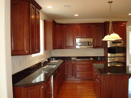 Granite Kitchen Floors Cabinetry With Two Level Of Granite Countertop Also Wooden
