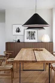 dining wood table with wishbone chairs elegant minimal wooden sideboard black pendant lights brown white black clic