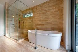 bath glass doors wood like tile with floor mounted faucet paired multi head shower with freestanding