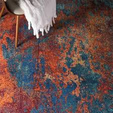 featuring a sensational silky texture and breathtaking tone this contemporary area rug from nourison is downright dazzling in its