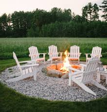 adirondack chairs around an outdoor fire pit