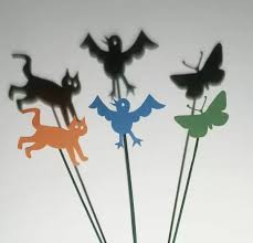 Cut Out Cat Bird And Butterfly Shapes And Their Shadows