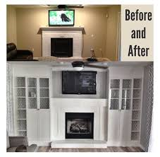 diy fireplace built ins using 4 ikea billy bookcases added glass doors to the inside two then cut the outer two down to size lined the backs with