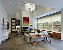 delightful lighting above fireplace contemporary living room in toronto with media cabinet and modern chandelier