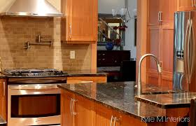Natural Cherry Cabinets In Kitchen With Black Granite Prep Sink