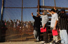 is illegal immigration really hurting us the sandbox news a group of recently deported immigrants stand near the double steel fence that separates san diego