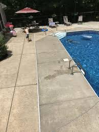 concrete patio. The Concrete Around This Swimming Pool Is Two Different Shades. There Are  Several Ways To Make It Look Much Better And Change The Color At Same Time. Patio
