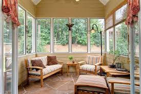 sunroom decor. Living Room:Amazing Sunroom With Striped Furnishings And Black Arch Stand Lamp Amazing Decor