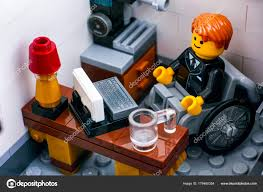 lego office. Lego Office Worker In Wheelchair On His Workplace \u2014 Stock Photo
