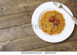 dinner table background. A Dish Of Tomato Risotto On Rustic Wooden Dinner Table Background Forming Page Border