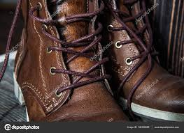 background of pair or couple close up view of brown leather man or woman new dry clean shoes showing laces in detail stock image