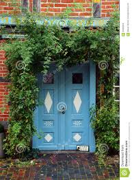 blue front door in a historic house with climbing plants at the stock photo image of decoration gate 60266358