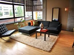 chic furniture of feng shui living room decoration with black sofa also barcelona chair medium