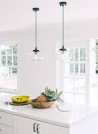 lighting over a kitchen island. Industrial Hanging Pendant Lights Over The White Granite Composite Counter On Kitchen Island In This Lighting A