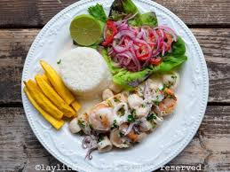 Grilled fish with creamy seafood sauce ...