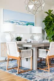 modern coastal furniture. contemporary modern becki owens estillo project dining room  modern coastal dining with woven  chairs geometric brass pendants and blue eskayal rug to modern coastal furniture