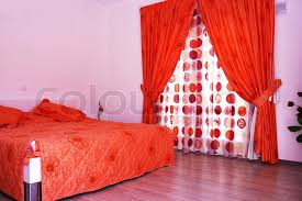 Superior Bedroom With Pink Walls, Red Curtains And Bedspread | Stock Photo |  Colourbox
