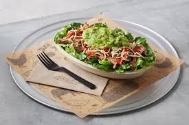 keto salad bowl on a metal tray with a fork and napkin