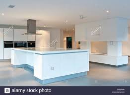 All White Kitchen Extractor Above Island Unit In Large Empty All White Kitchen In