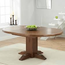 trina dark solid oak round extending dining table 7136