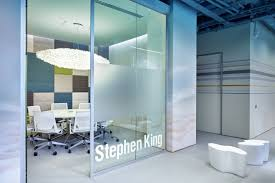 design of office. gold bar hovering in the rising sun clouds \u2014 became central element of design whole office. is reception desk office