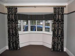 how to hang curtains in a bay window hanging curtains in bay window for windows living