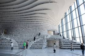 A futuristic Chinese library has wowed book lovers around the world with  its white, undulating