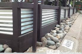 corrugated metal and wood fence creating a modern wood metal retaining wall fence how to build