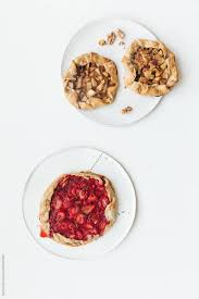 Fresh Baked Very Tasty Vegan Fruit Pies On Ceramic Plates With