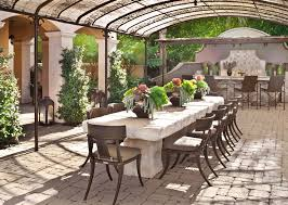 faux stone outdoor dining table. khloe kardashian - incredible covered patio with solid stone dining table lined restoration hardware klismos luxe side chairs over brick pavers. faux outdoor a