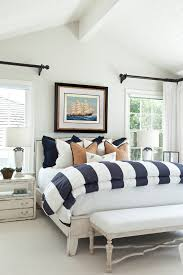 beach style bedroom with white walls distressed furniture and simple yet cute bedding set