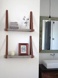 diy shelving made from recycled milk painted pine and leather straps