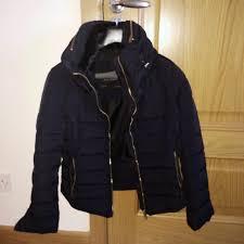 BNWOT Zara black short quilted jacket. Gold zippers on pockets ... & BNWOT Zara black short quilted jacket. Gold zippers on pockets,sleeves and  rear of jacket (see pics)! Fur lined collar with hidden hood. Adamdwight.com