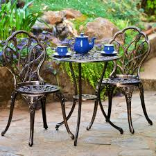 patio metal patio table wrought iron patio chairs costco two cups and teapot with blue