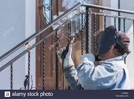 Wrought Iron Handrails A Worker Welding Metal Handrails On The Stairs Wrought Iron Stock
