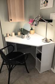 Corner table vanity The BORGSJ corner desk tucks neatly in a corner, with  enough top space and storage to make morning prep easy!