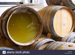 oak barrels stacked top. Oak Barrels For Fermenting And Aging White Wine. One Barrel Has The Wooden End Removed Replaced By A Plexi Glass Sheet To Allow Inspection Of Wine Stacked Top