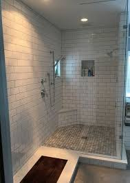 a heated floor was installed with the herringbone pattern and next to the shower a teak wood floor was inlaid with the tile