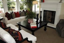 small living room with a tall narrow fireplace and white furniture big furniture small living room