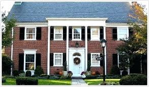 red brick house with shutters red brick house with black shutters brick white columns blue shutters red brick house