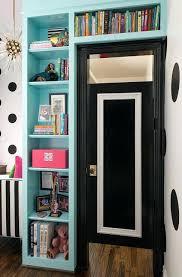 turquoise bookshelves surrounding doorway bookcase closet door plans bookcase closet door