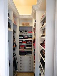 interior small walk in closet with wire hanging shelves short dresser for closet