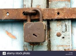 old lock closing system of door stock image