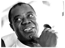 til louis armstrong played the trumpet so much that it caused tried looking for a good pic showing his callused mouth