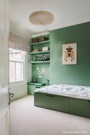 Green is great for a kids bedroom. With such a simple bedroom this leaves  loads